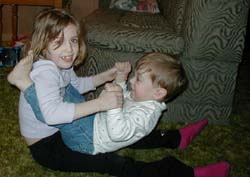 Kymberley and Mikey play together at home